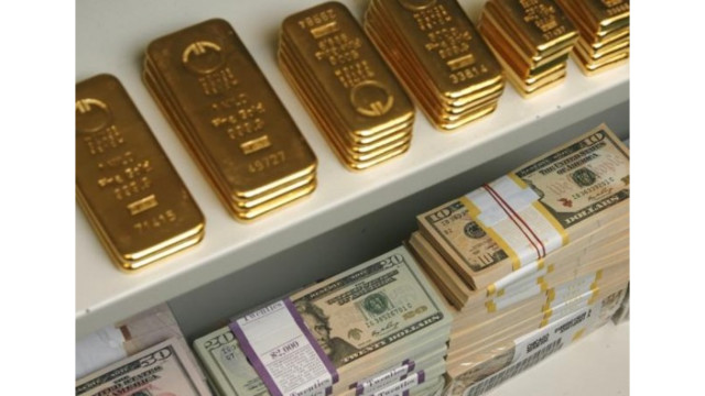 Currency Wars Gold Bars And Us Dollar Bills Are Pictured In A Safe Bank